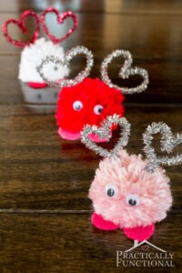 how-to-make-valentines-day-pom-pom-monsters-practically-functional